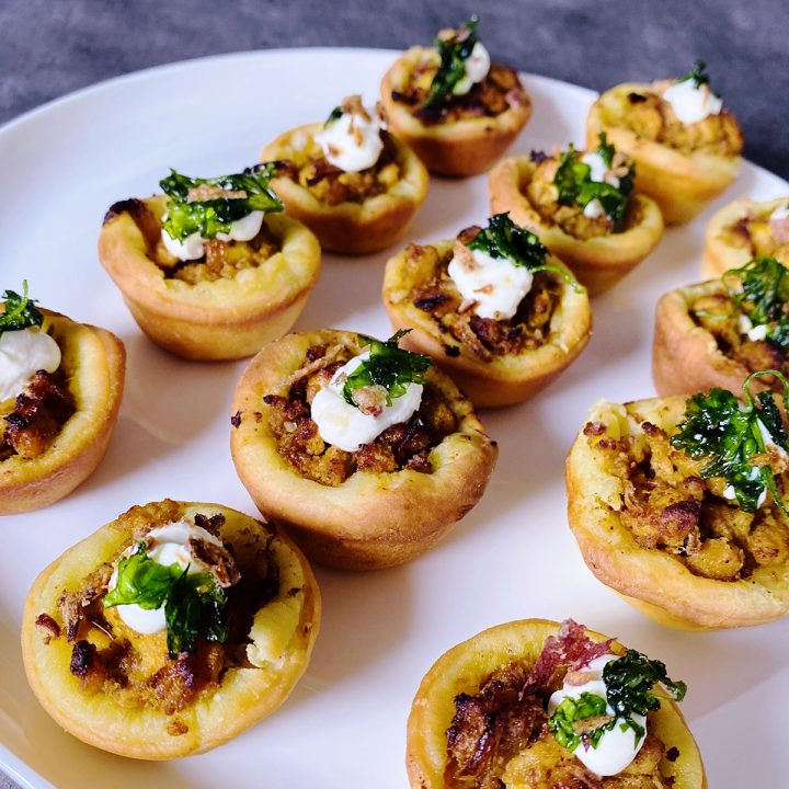 pickled chicken naan bread cups on a plate